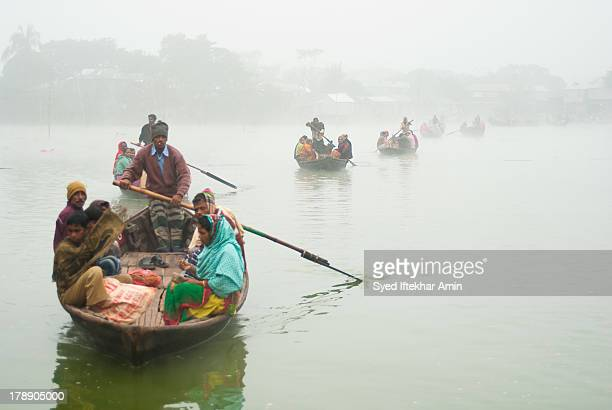 Dwellers on the water-slums in the capital Dhaka cross the lake in Gulshan by boat to reach the main street and go about livelihoods. Rents on the...