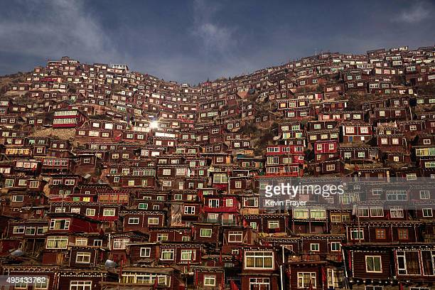 Dwellings where Tibetan Buddhist nuns and monks live are seen on a hillside at Larung Wuming Buddhist Institute on October 30 2015 in Sertar county...