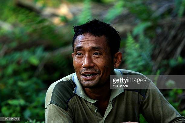 Dwi Farmer on the oil palm plantations on February 28, 2012 in Bintan Island, Indonesia. Indonesian palm oil producers have been hit by the...