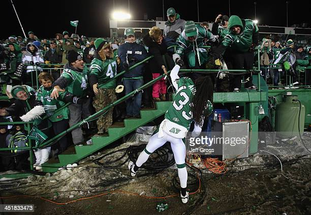 Dwight Anderson of the Saskatchewan Roughriders celebrates with fans following his teams 4523 victory over the Hamilton TigerCats during the 101st...