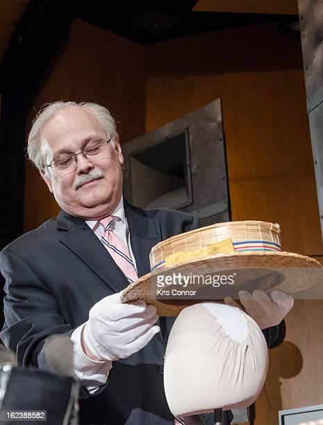 Dwight Blocker Bower places Joel Grey's hat on display during the Cabaret Washington DC Screening Honoring Joel Grey at Smithsonian National Museum...