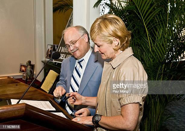 Dwight Blocker Bowers curator National Museum of American History looks on as Julia Perry of Twentieth Century Fox Films signsover XFiles memorabilia...