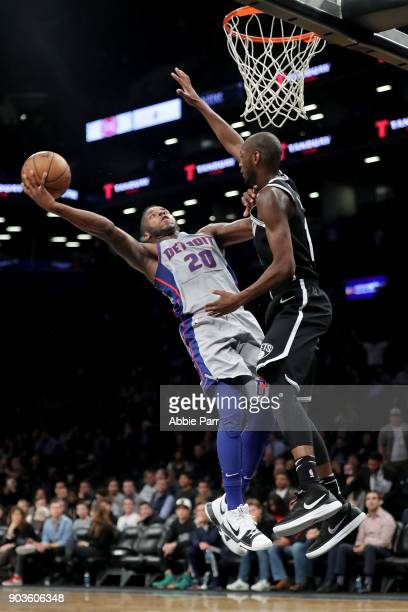 Dwight Buycks of the Detroit Pistons takes a shot against Milton Doyle of the Brooklyn Nets in the fourth quarter during their game at Barclays...