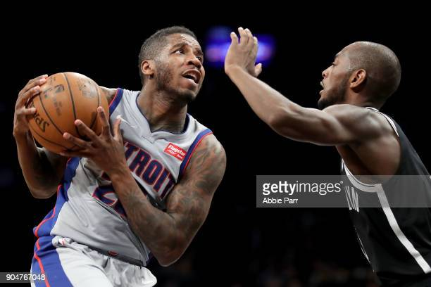 Dwight Buycks of the Detroit Pistons works against Milton Doyle of the Brooklyn Nets in the fourth quarter during their game at Barclays Center on...