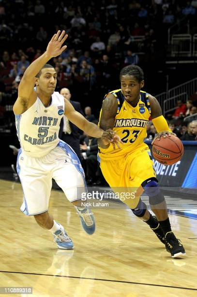 Dwight Buycks of the Marquette Golden Eagles goes for a layup gainats Kendall Marshall of the North Carolina Tar Heels during the east regional...