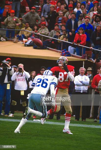 Dwight Clark of the San Francisco 49ers catches a pass over Michael Downs of the Dallas Cowboys during an NFL football game at Candlestick Park...