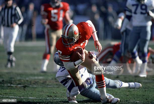 Dwight Clark of the San Francisco 49ers gets tackled by Ron Fellows of the Dallas Cowboys during an NFL football game December 22 1985 at Candlestick...
