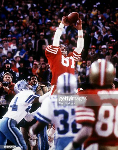 Dwight Clark of the San Francisco 49ers makes a touchdown catch on a pass from Joe Montana to score the game winning touchdown against the Dallas...