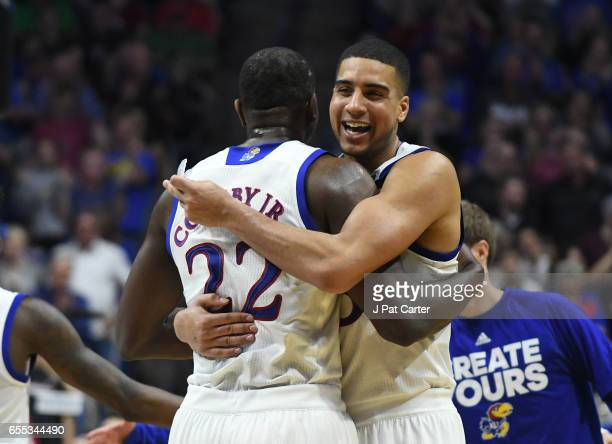 Dwight Coleby and Landen Lucas of the Kansas Jayhawks celebrate their victory over the Michigan State Spartans during the second round of the 2017...