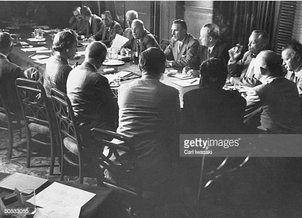 Dwight D. Eisenhower during meeting, with Richard M. Nixon at his left and Arthur E. Summerfield at his right.
