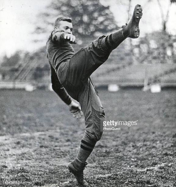 Dwight D. Eisenhower when he was a cadet at West Point, punting a football, West Point, New York, 1915. He played in the backfield on the West Point...
