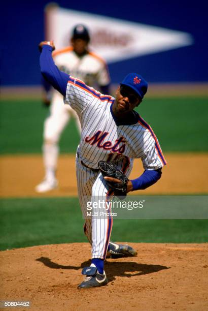 Dwight Doc Gooden of the New York Mets pitches during a game at Shea Stadium in Flushing New York Gooden played for the Mets from 18841994