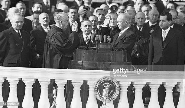 Dwight Eisenhower takes the oath of office from Chief Justice Fred Moore Vinson . To the far left is Harry Truman, outgoing President, and to the far...