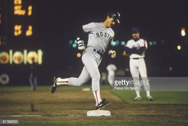 Dwight Evans of the Boston Red Sox rounds third base after clouting a homerun during the World Series against the New York Mets at Shea Stadium on...