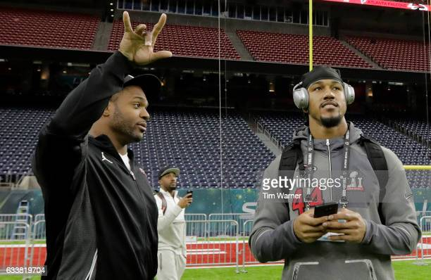 Dwight Freeney of the Atlanta Falcons talks with Vic Beasley during the Super Bowl LI team walk through at NRG Stadium on February 4 2017 in Houston...