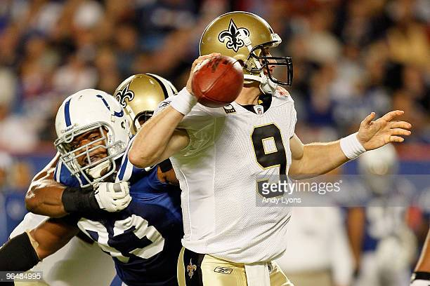 Dwight Freeney of the Indianapolis Colts pressures Drew Brees of the New Orleans Saints during Super Bowl XLIV on February 7 2010 at Sun Life Stadium...