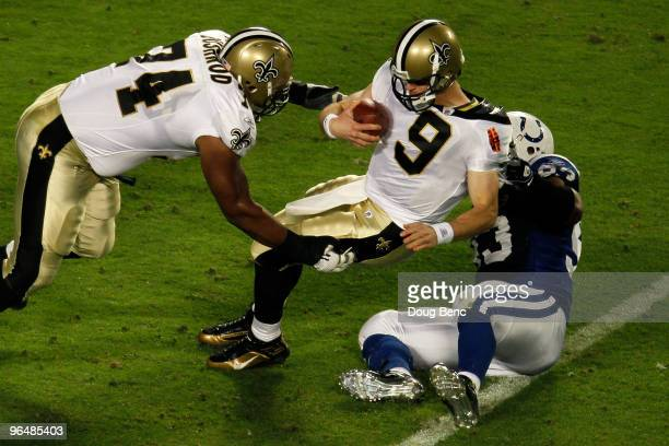 Dwight Freeney of the Indianapolis Colts sacks Drew Brees of the New Orleans Saints during Super Bowl XLIV on February 7 2010 at Sun Life Stadium in...