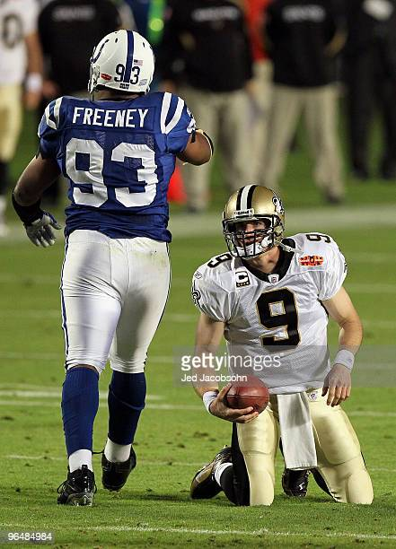 Dwight Freeney of the Indianapolis Colts walks away after sacking Drew Brees of the New Orleans Saints during Super Bowl XLIV on February 7 2010 at...
