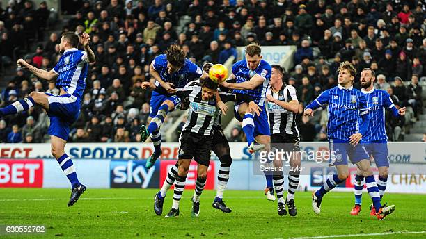 Dwight Gale of Newcastle United battles with Sam Hutchinson of Sheffield Wednesday and Tom Lees of Sheffield Wednesday with no foul given during the...