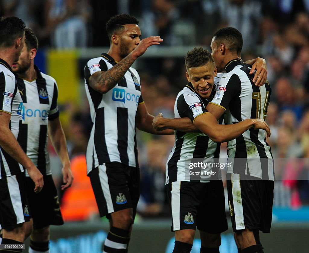 Dwight Gale of Newcastle United (09) celebrates with Isaac Hayden (14) after scoring Newcastle's fourth goal from a free kick during the Sky Bet Championship match between Newcastle United and Reading at St.James' Park on August 17, 2016, in Newcastle upon Tyne, England.