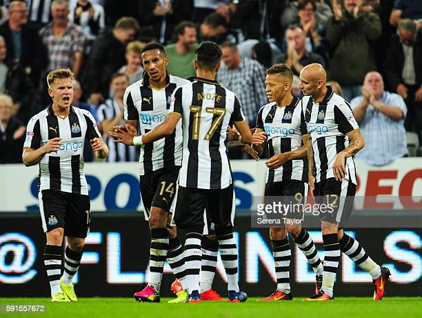 Dwight Gale of Newcastle United celebrates with teammates after scoring Newcastle's third goal from a free kick during the Sky Bet Championship match...