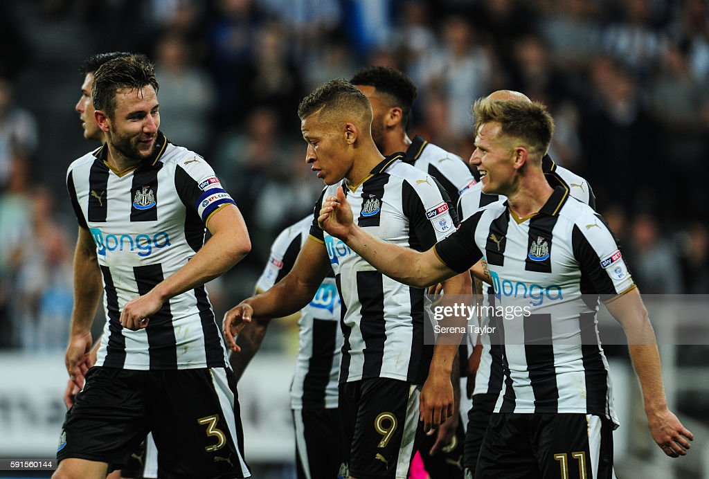 Dwight Gale of Newcastle United (09) celebrates with teammates after scoring Newcastle's fourth goal from a free kick during the Sky Bet Championship match between Newcastle United and Reading at St.James' Park on August 17, 2016, in Newcastle upon Tyne, England.