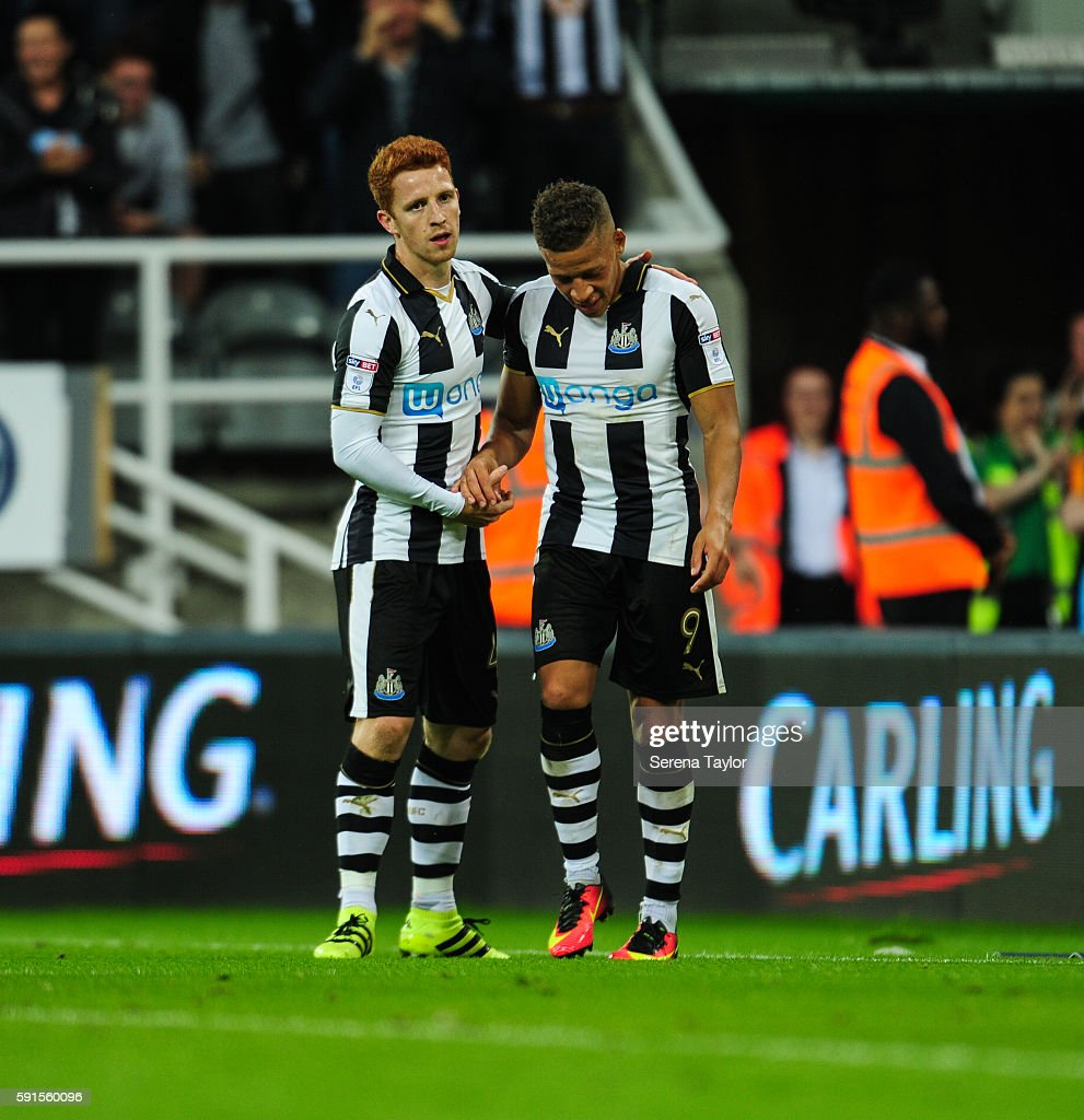 Dwight Gale of Newcastle United (09) is congratulated by teammate Jack Colback (L) after scoring Newcastle's fourth goal from a free kick during the Sky Bet Championship match between Newcastle United and Reading at St.James' Park on August 17, 2016, in Newcastle upon Tyne, England.
