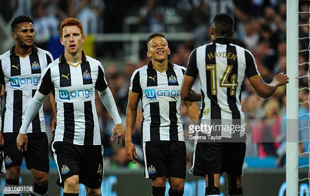 Dwight Gale of Newcastle United looks to celebrate with Isaac Hayden after scoring Newcastle's fourth goal from a free kick during the Sky Bet...