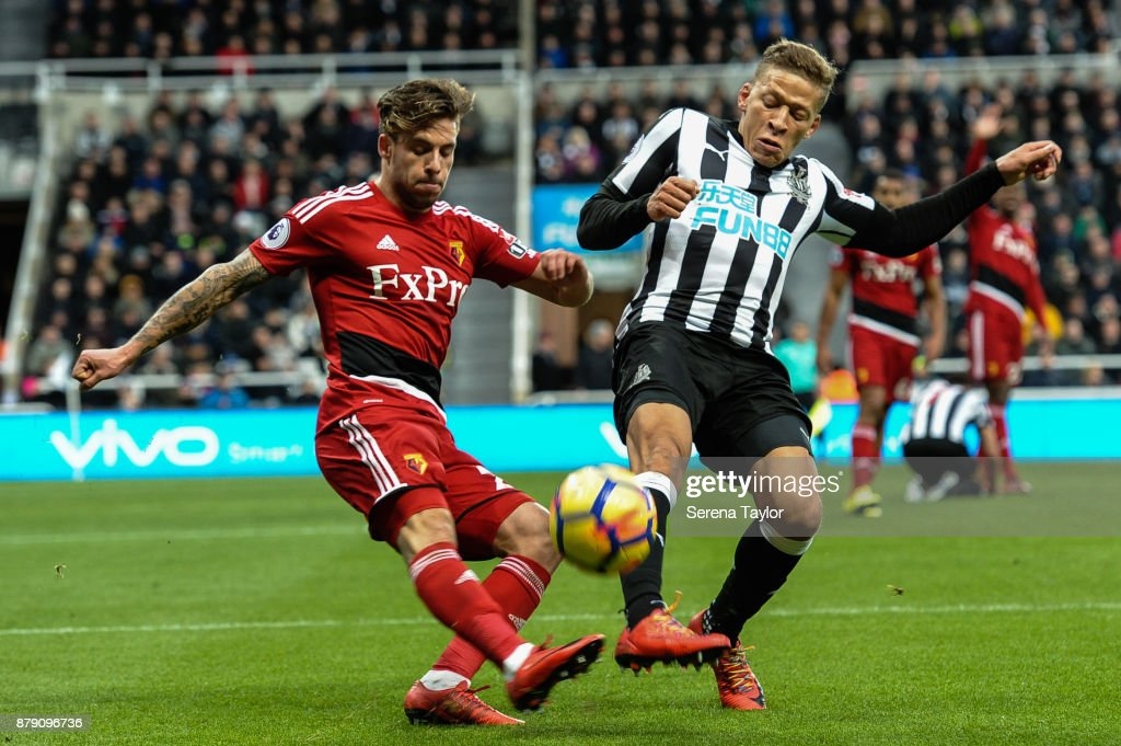 Dwight Gale of Newcastle United (09) tries to intercept the ball from Kiko Femenia of Watford (21) during the Premier League match between Newcastle United and Watford F.C. at St.James' Park on November 25, 2017, in Newcastle upon Tyne, England.