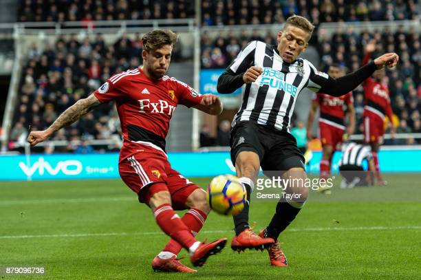 Dwight Gale of Newcastle United tries to intercept the ball from Kiko Femenia of Watford during the Premier League match between Newcastle United and...