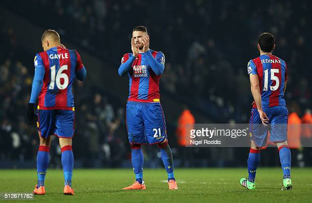 Dwight Gayle Connor Wickham and Mile Jedinak of Crystal Palace look dejected after the Barclays Premier League match between West Bromwich Albion and...
