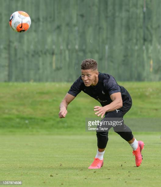 Dwight Gayle heads the ball during the Newcastle United Training Session at the Newcastle United Training Centre on July 24 2020 in Newcastle upon...