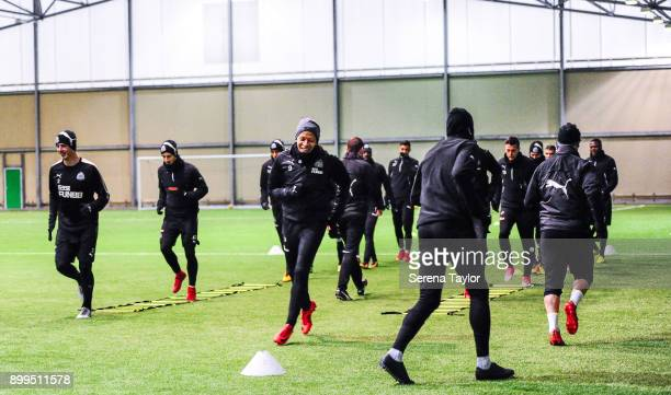 Dwight Gayle is all smiles as he warms up with the group during the Newcastle United Training session at the Newcastle United Training Centre on...
