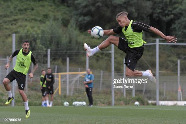Dwight Gayle jumps in the air to strike the ball during the Newcastle United Pre Season Training Session at the Sporting Clube de Braga on July 30 in...
