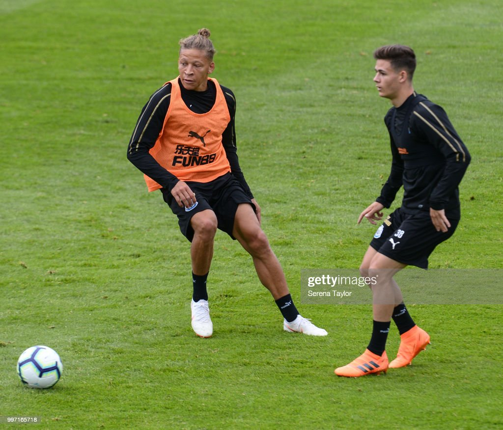 Dwight Gayle (L) looks to close down Victor Fernandez during the Newcastle United Training session at Carton House on July 12, 2018, in Kildare, Ireland.