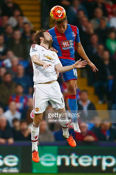 Dwight Gayle of Crystal Palace and Daley Blind of Manchester United compete for the ball during the Barclays Premier League match between Crystal...