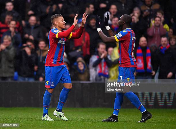 Dwight Gayle of Crystal Palace celebrates his goal with Yannick Bolasie of Crystal Palace during the Barclays Premier League match between Crystal...