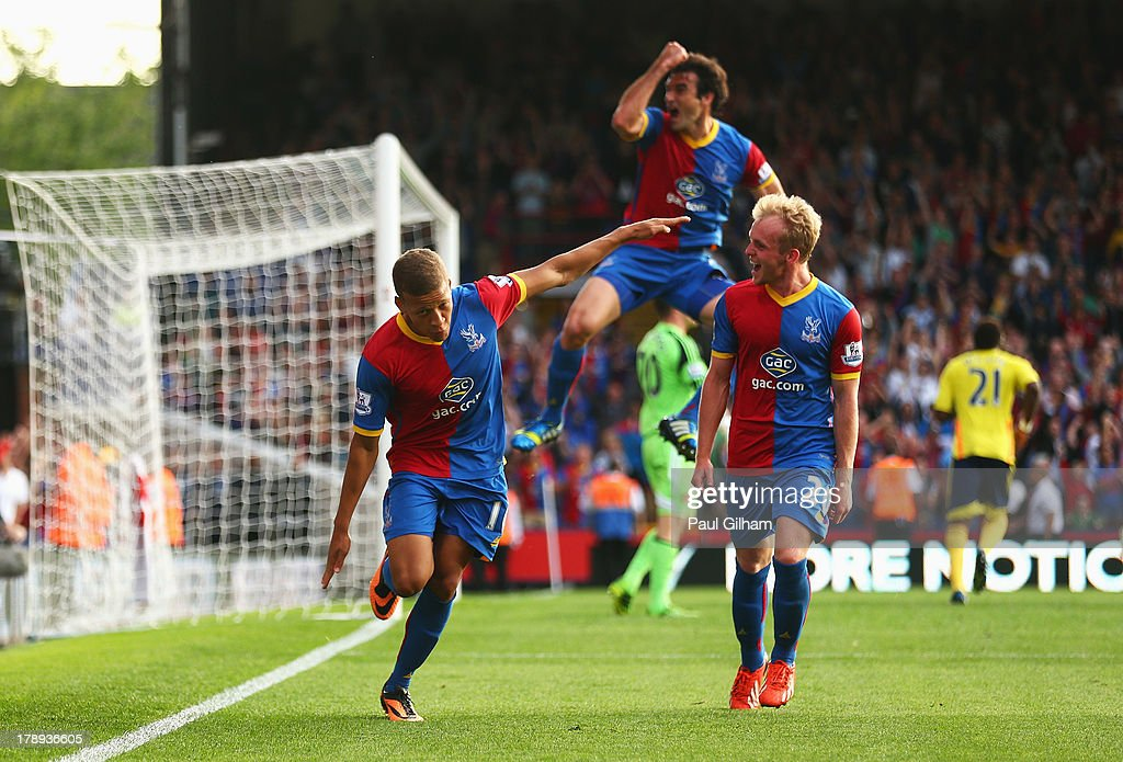 Dwight Gayle (L) of Crystal Palace celebrates scoring his penalty during the Barclays Premier League match between Crystal Palace and Sunderland at Selhurst Park on August 31, 2013 in London, England.