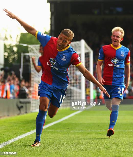 Dwight Gayle of Crystal Palace celebrates scoring his penalty with Jonathan Williams during the Barclays Premier League match between Crystal Palace...