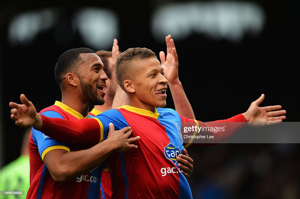 Dwight Gayle (R) of Crystal Palace celebrates scoring his second goal during the Barclays Premier League match between Fulham and Crystal Palace at Craven Cottage on May 11, 2014 in London, England.