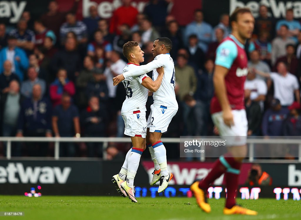 Dwight Gayle (L) of Crystal Palace celebrates scoring his team's second goal with his team mate Jason Puncheon (R) during the Barclays Premier League match between West Ham United and Crystal Palace at the Boleyn Ground on April 2, 2016 in London, England.