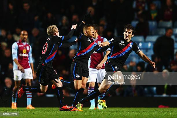 Dwight Gayle of Crystal Palace celebrates with team mates after scoring the winning goal during the Barclays Premier League match between Aston Villa...