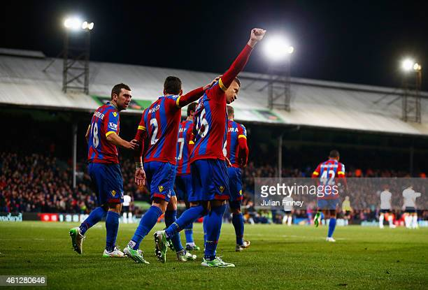 Dwight Gayle of Crystal Palace celebrates with team mates as he scores their first and equalisin goal from a penalty during the Barclays Premier...