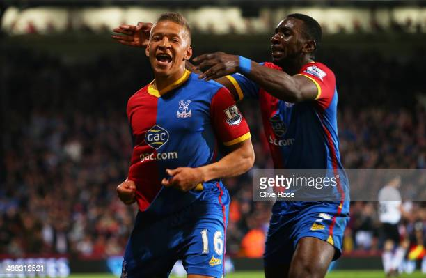 Dwight Gayle of Crystal Palace celebrates with teammate Yannick Bolasie after scoring his team's third goal to level the scores at 33 during the...