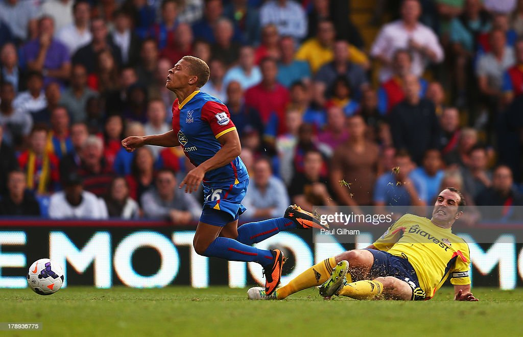 Dwight Gayle of Crystal Palace is brought down in the penalty area by John O'Shea of Sunderland leading to a penalty and his sending off during the Barclays Premier League match between Crystal Palace and Sunderland at Selhurst Park on August 31, 2013 in London, England.