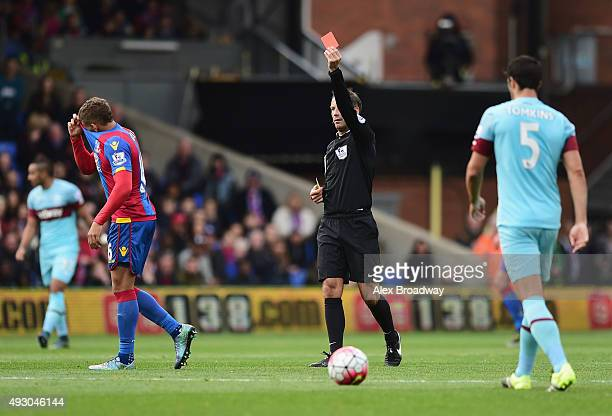 Dwight Gayle of Crystal Palace is shown a red card by referee Mark Clattenburg during the Barclays Premier League match between Crystal Palace and...