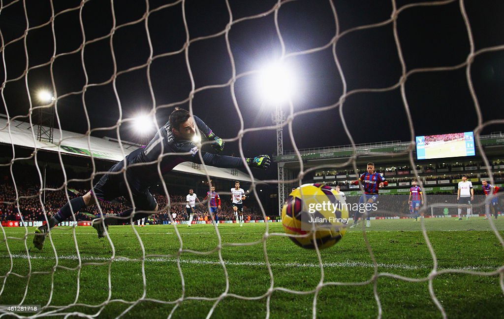 Dwight Gayle of Crystal Palace scores their first and equalising goal from a penalty past goalkeeper Hugo Lloris of Spurs during the Barclays Premier League match between Crystal Palace and Tottenham Hotspur at Selhurst Park on January 10, 2015 in London, England.