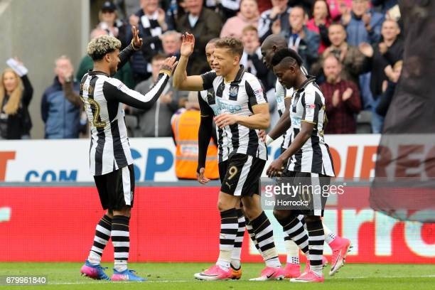 Dwight Gayle of Newcastle celebrates scoring the third goal during the Sky Bet Championship match between Newcastle United and Barnsley at St James'...