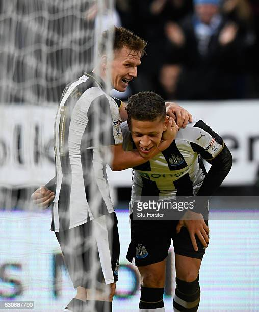 Dwight Gayle of Newcastle celebrates with Matt Ritchie after scoring the third Newcastle goal during the Sky Bet Championship match between Newcastle...