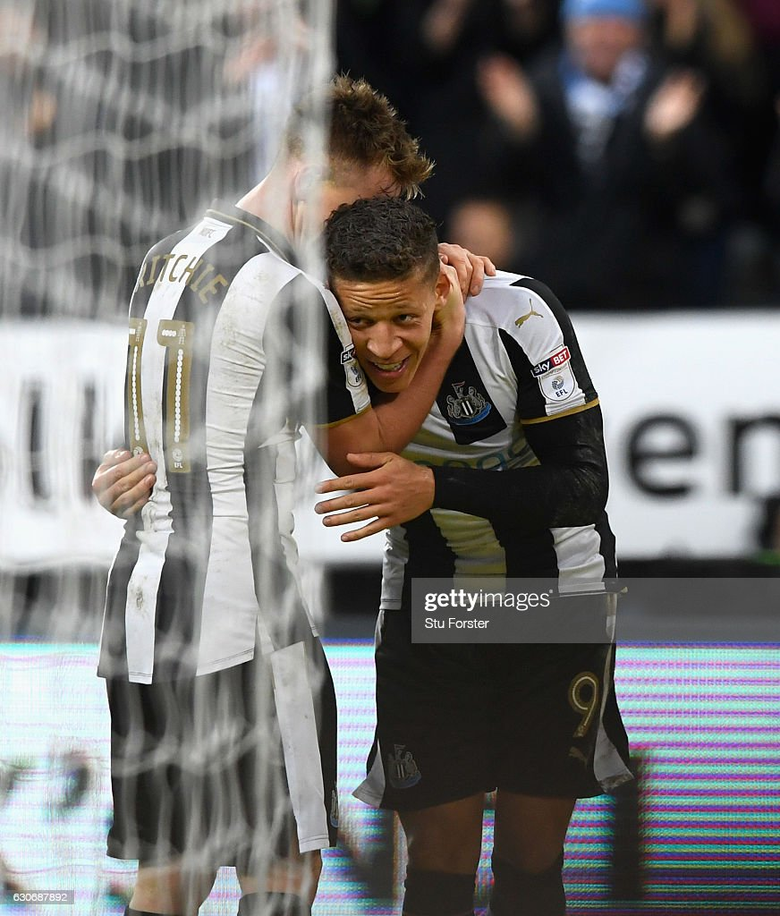 Dwight Gayle of Newcastle (r) celebrates with Matt Ritchie after scoring the third Newcastle goal during the Sky Bet Championship match between Newcastle United and Nottingham Forest at St James' Park on December 30, 2016 in Newcastle upon Tyne, England.